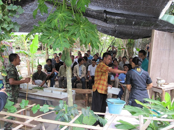Military EM leaders giving lecture to farmers