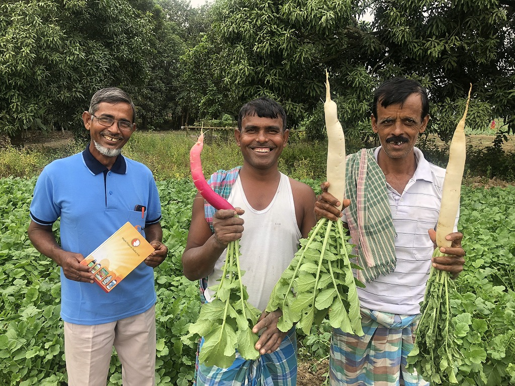 Happy farmers with great harvest