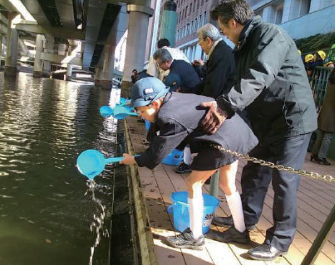 "Under the slogan of ""Bring back Salmon to Tokyo Bay"", releasing salmon fry into the Nihonbashi River, an activity that began in 2012"